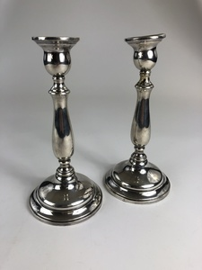 Pair of Cartier Sterling and Weighted Candlesticks